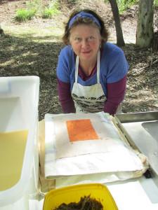 Zela demonstrating paper making